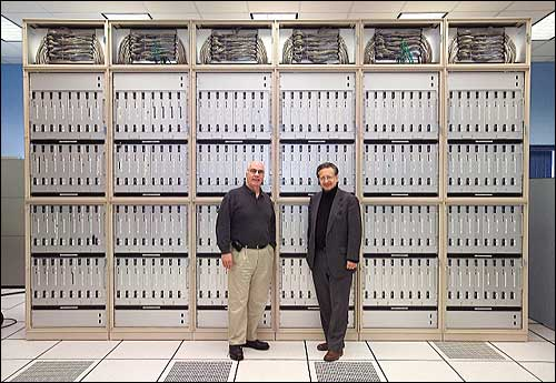 Edward McFadden and Nicholas Samios in front of QCDOC supercomputer