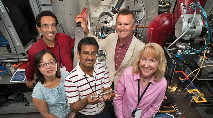 Sanjit Ghose, center, with colleagues