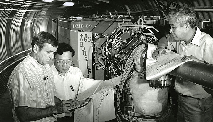 Andy McNerney, Bill Weng, and Y.Y. Lee inside the Booster tunnel