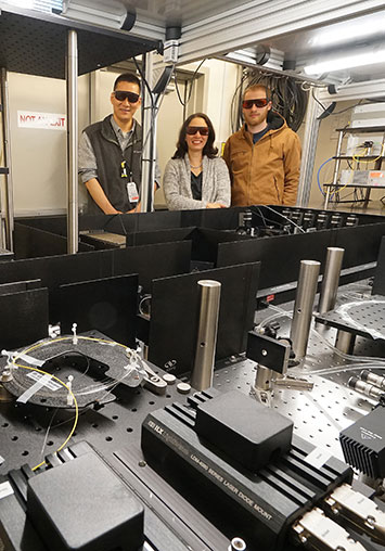 Team with tabletop laser housing