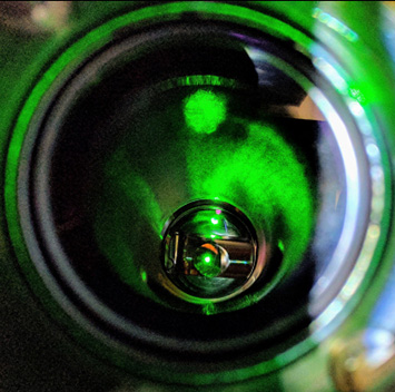 Small circular view of green laser