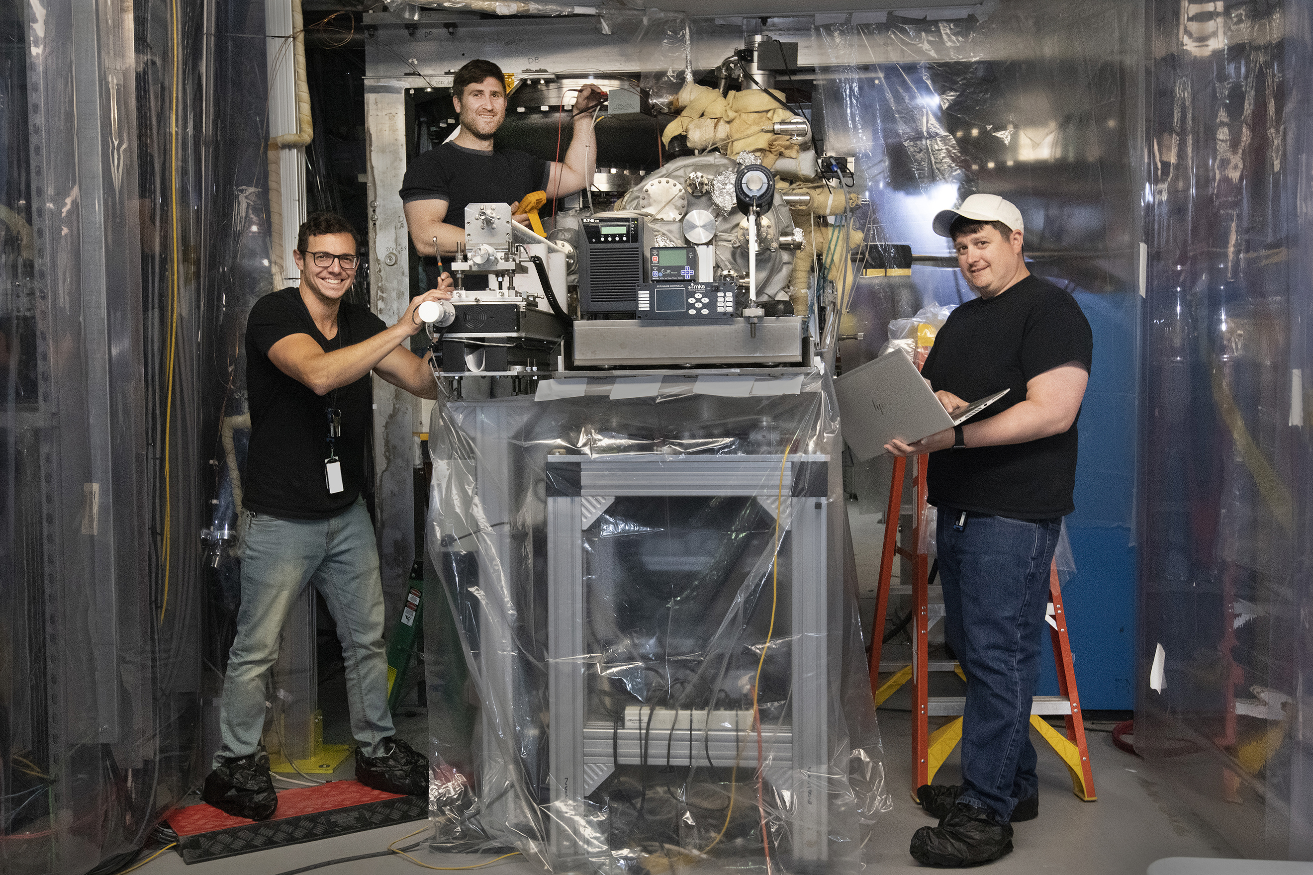 Members of Collider-Accelerator Department vacuum group next to the cathode insertion device (l to r): Mike Nicoletta, Kirk Sinclair, and Ken Decker.