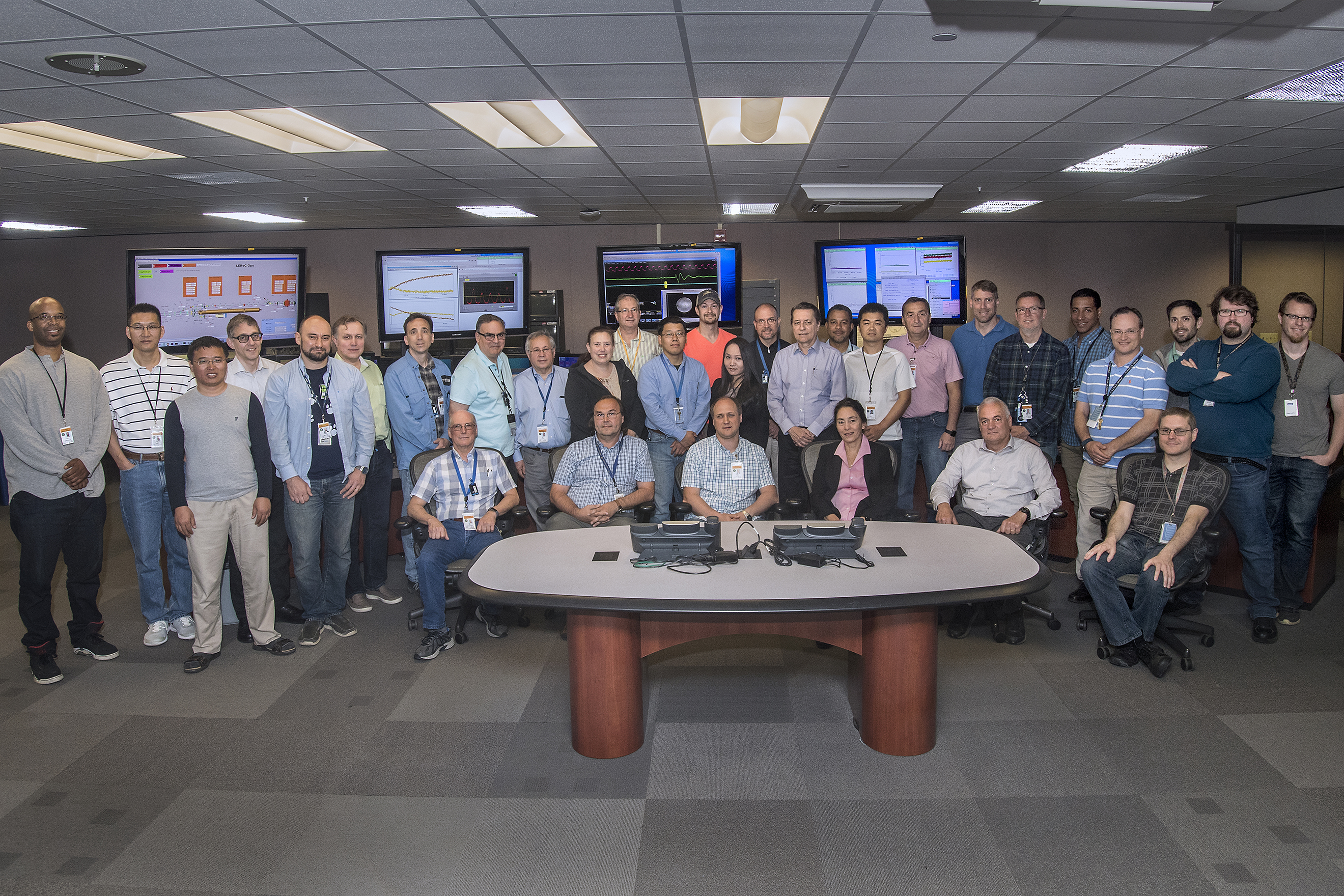 Some members of the Low Energy RHIC electron Cooling (LEReC) team in the Main Control Room of Brookhaven Lab's Collider-Accelerator Department. The team successfully demonstrated a bunched-beam electron cooling technique at RHIC, opening up the possibility of applying this technique to produce high-quality ion beams at high energies.