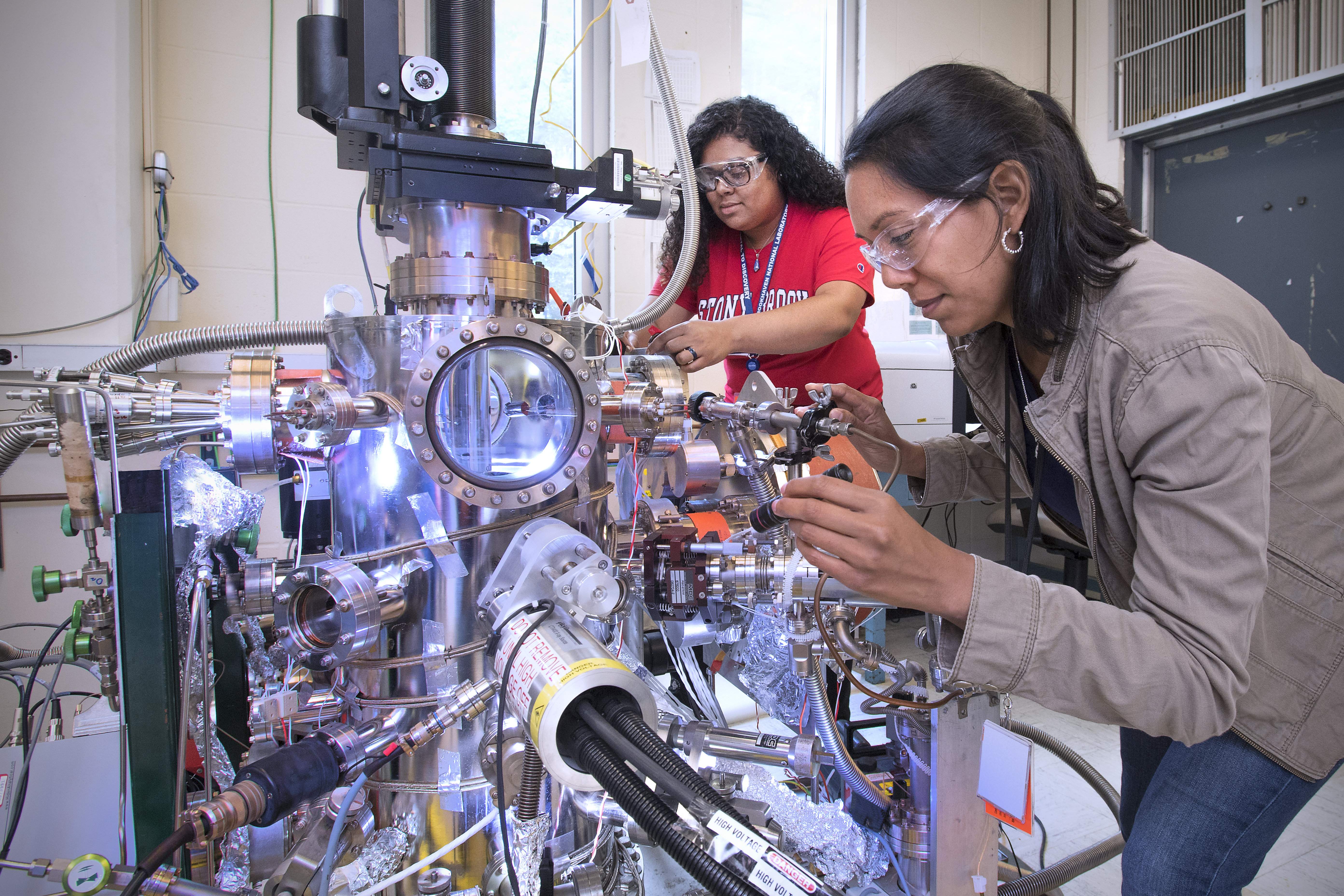 Nylette Lopez (rear) and Stephanie Taboada use state-of-the-art equipment to characterize catalysts as they seek ways to convert carbon dioxide and methane into synthesis gas.