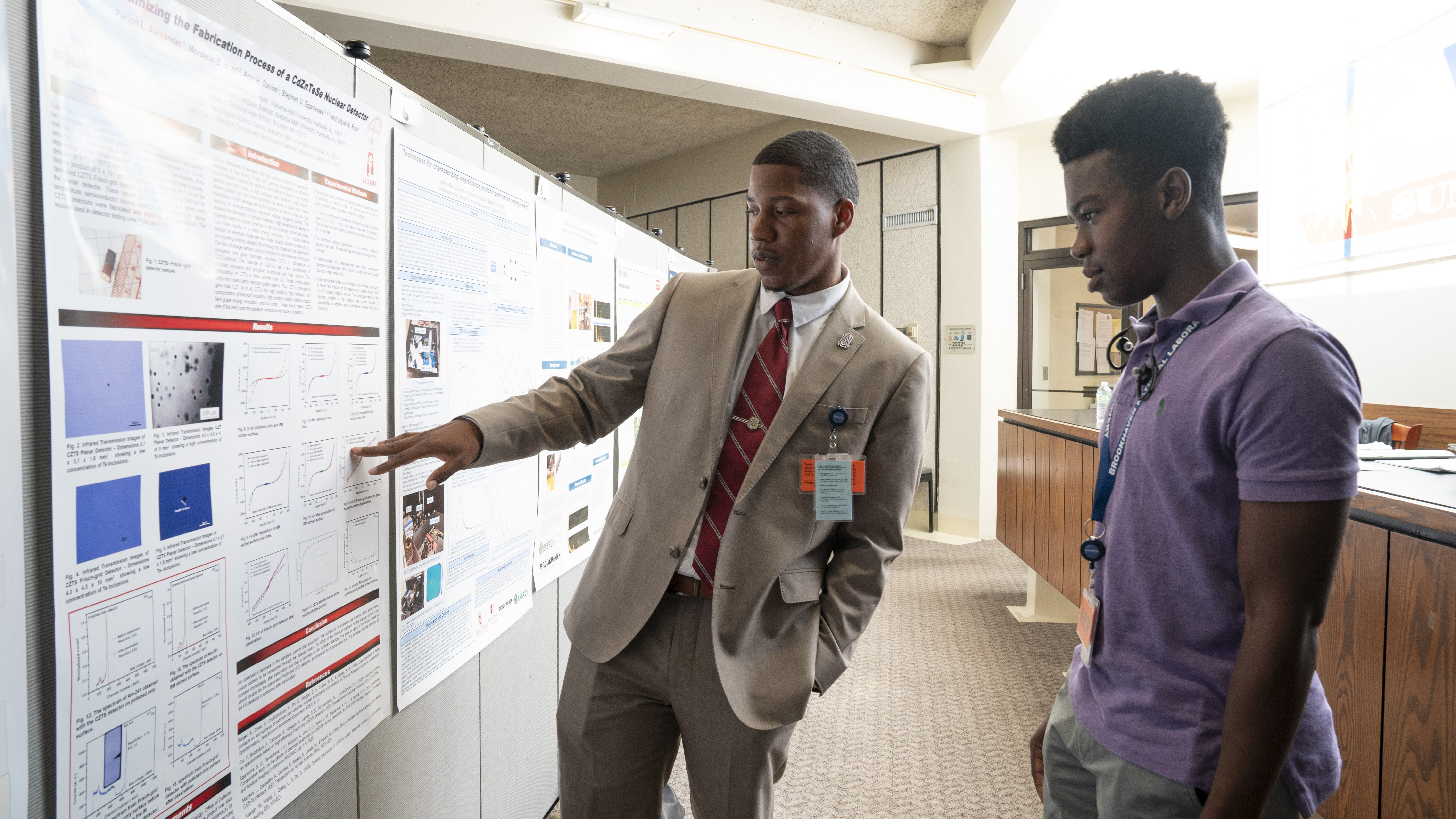 Brookhaven interns discussed their summer research projects with their peers and Lab staff during a poster session that preceded the closing ceremony.