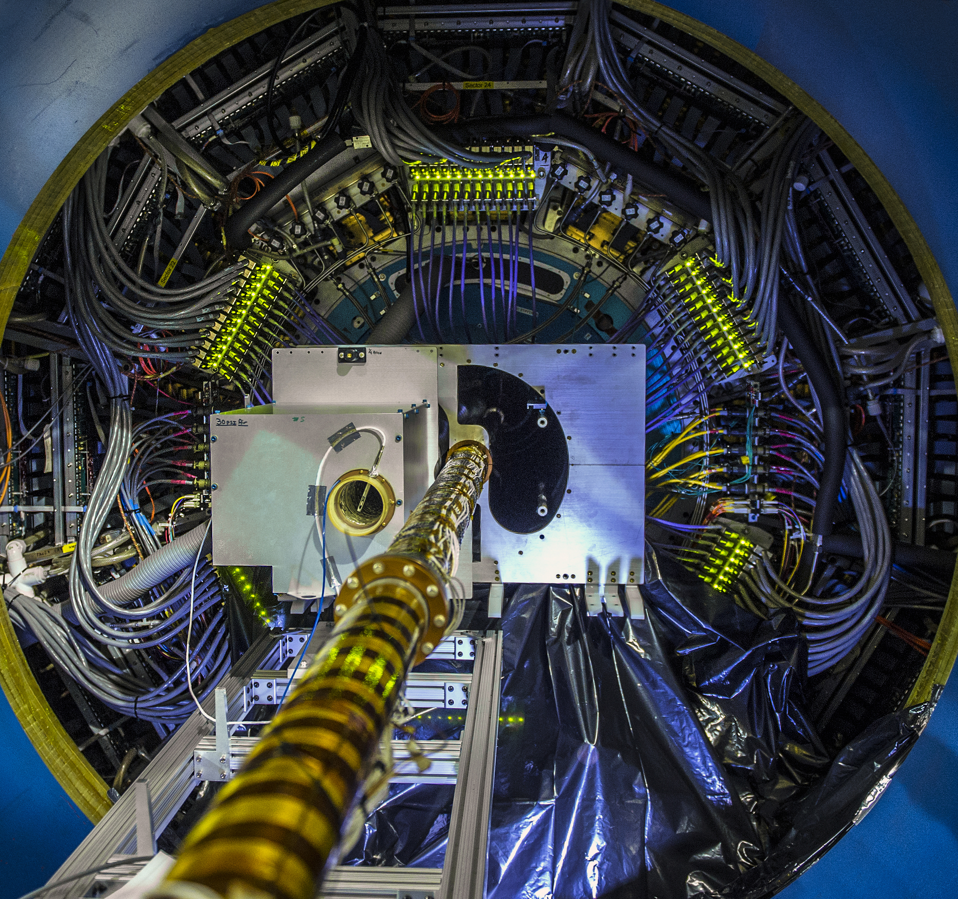 The central portion of the Heavy Flavor Tracker (HFT) being installed at the Relativistic Heavy Ion Collider's STAR detector. The HFT tracks particles made of