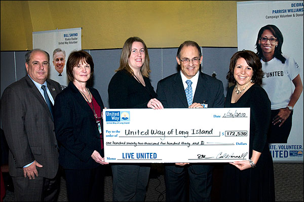 United Way representatives receive a $172,530 check