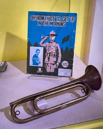 sheet music from well-known American composer Irving Berlin and a bugle from the World War I era