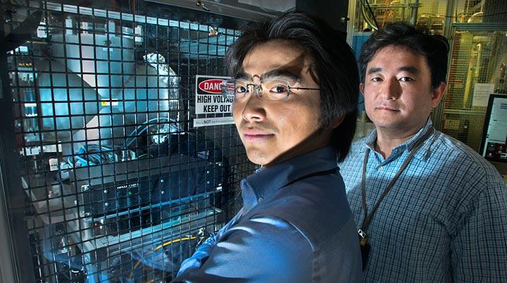 Takeshi Kanesue (left) and Masahiro Okamura